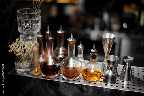 decanters with alcoholic drinks stand on the bar counter