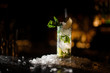 canvas print picture - alcoholic cocktail mojito stands on a bar counter
