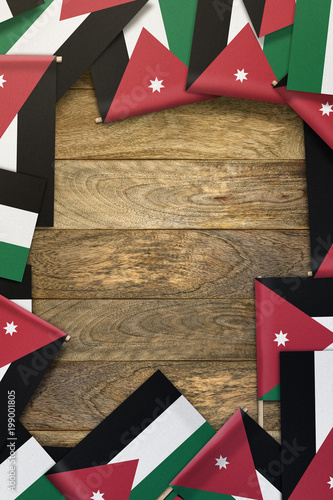 Fotografie, Obraz  Jordan small flags framing a wood texture background with copy space