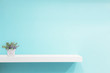 Leinwanddruck Bild - Empty white shop shelf, retail shelf on blue vintage background.