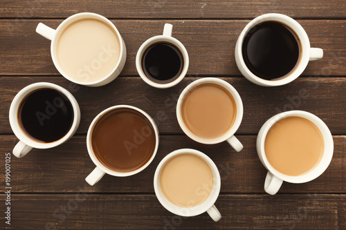 Wall Murals Cafe Different types of coffee in cups on wooden table, top view