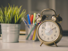 Vintage Alarm Clock And Pen Box, Flower Pot On Table Desk.