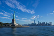 The Statue of Liberty in front of the New York skyline