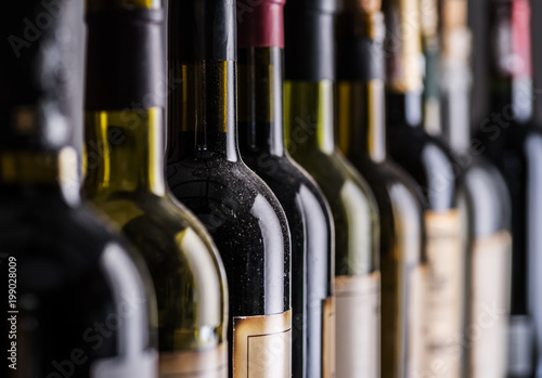 Foto op Canvas Alcohol Line of wine bottles. Close-up.
