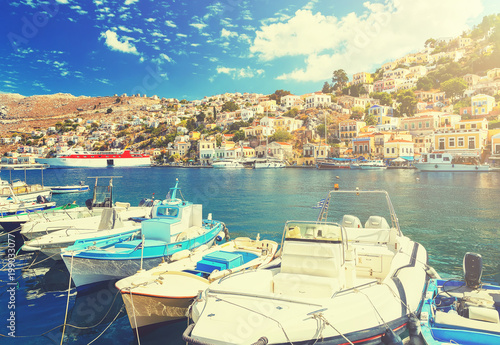 In de dag Stad aan het water Traditional Greek fishing boats in harbour at Symi Town in the Dodecanese Greece Europe