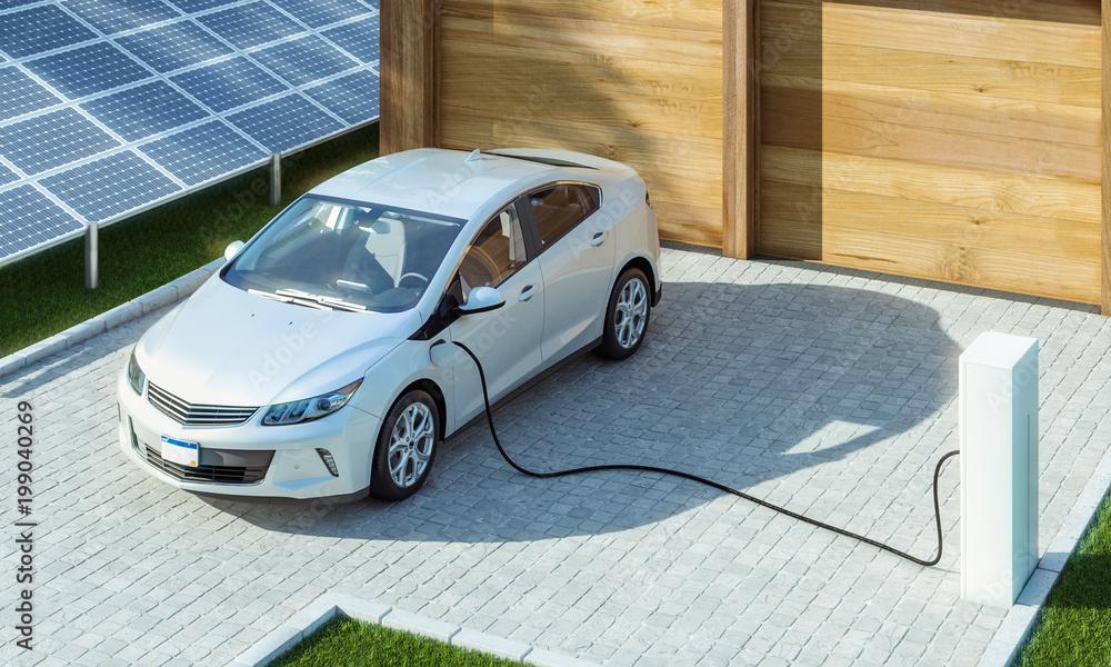 Fototapeta Modernes Elektroauto zu Hause Strom tanken