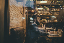 Bearded Man Rest In Restaurant With Beer Glass. Serious Bar Customer Sit In Cafe Drinking Ale. Date Meeting Of Hipster Awaiting In Pub. Beer Time. Businessman With Long Beard Drink In Cigar Club.