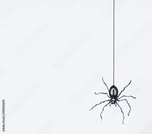 Montage in der Fensternische Surrealismus Illustration-sketch of a black spider drawn in black china dangling isolated on a white sheet background