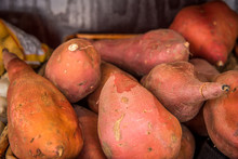 Sweet Potatoes And Yams In Basket