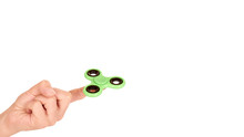 Green Fidget Spinner In Hand Isolated On White Background. Copy Space, Template