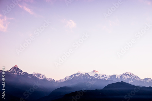 Tuinposter Purper The beautiful landscape of the Himalaya mountains, Nepal. Sunrise time. Layered mountains. Pokhara, Nepal. Image with copy space. Nature background. Mountains background. Magic moment at the morning.