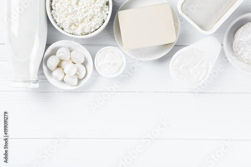 Fotobehang Zuivelproducten Dairy products on wooden table, top view