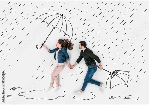 Fotografie, Obraz  creative hand drawn collage with couple running under rain with umbrellas