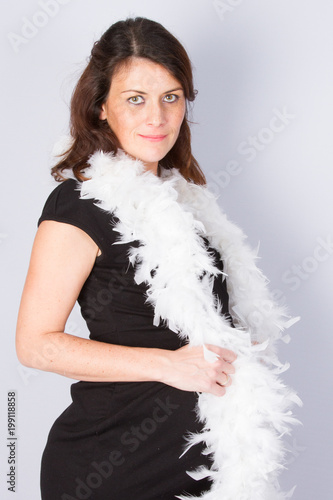 e880164555c81 cute pregnant woman in a black dress with a feather boa - Buy this ...