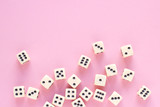 Gaming dice with copy space on pink background. Concept for games, game board, presentation, banners or web. Top view. Close-up.
