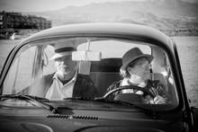 Mature Couple Drive An Old Vintage Car