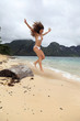 Attractive woman relaxing on exotic beach, Palawan Island, Philippines