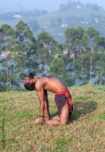 Indian Man Doing Yoga Exercises On Green Grass In Kerala South India Buy This Stock Photo And Explore Similar Images At Adobe Stock Adobe Stock