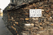 Calle Cortada Wooden Sign On Wall