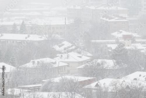 Obraz Snowfall in the city. - fototapety do salonu
