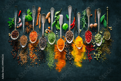Poster Aromatische Herbs and spices for cooking on dark background