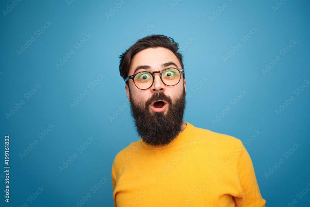 Fototapeta Super excited bearded hipster looking at camera