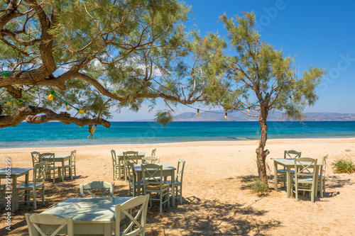 Платно Romantic greek tavern on the Plaka beach. Naxos island, Greece.