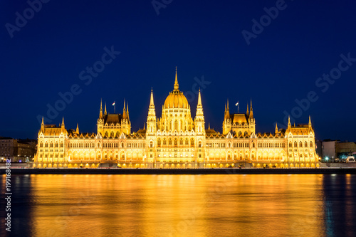 Fotobehang Boedapest Famous Budapest parliament at the river Danube during blue hour from the front