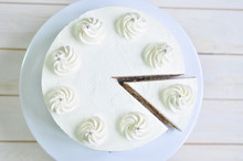 Triangular Piece Of Tender Biscuit Cake In White Cream With Cream Peaks And Silver Beads
