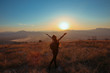 Sunset mountain. Tourist Free happy woman outstretched arms with backpack enjoying life in wheat field. Hiker cheering elated and blissful with arms raised