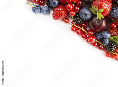 Black Blue And Red Food Mix Berries On A White Background With Copy Space