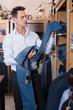 Customer examining trousers