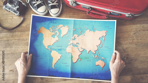 Woman holding map travel concepts