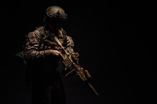 Special Forces United States Soldier Or Private Military Contractor Holding Rifle. Image On A Black Background.