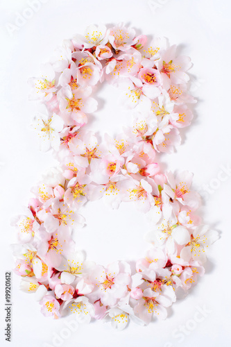 Fotografía  Arabic numeral eight lined with flowers on a white background