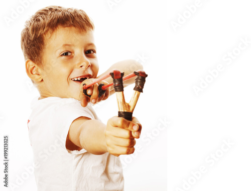 Fényképezés little cute angry real boy with slingshot isolated