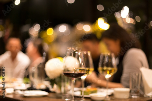 Fotomural Group of friends having a dinner and wine in blurred conceptaul