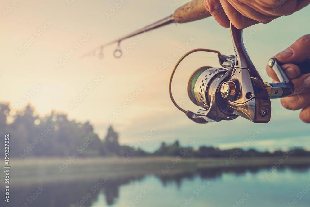 Fototapety, obrazy: Fishing on the lake at sunset. Fishing background.