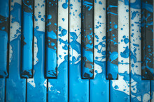 Old Piano Is Painted In Blue C...