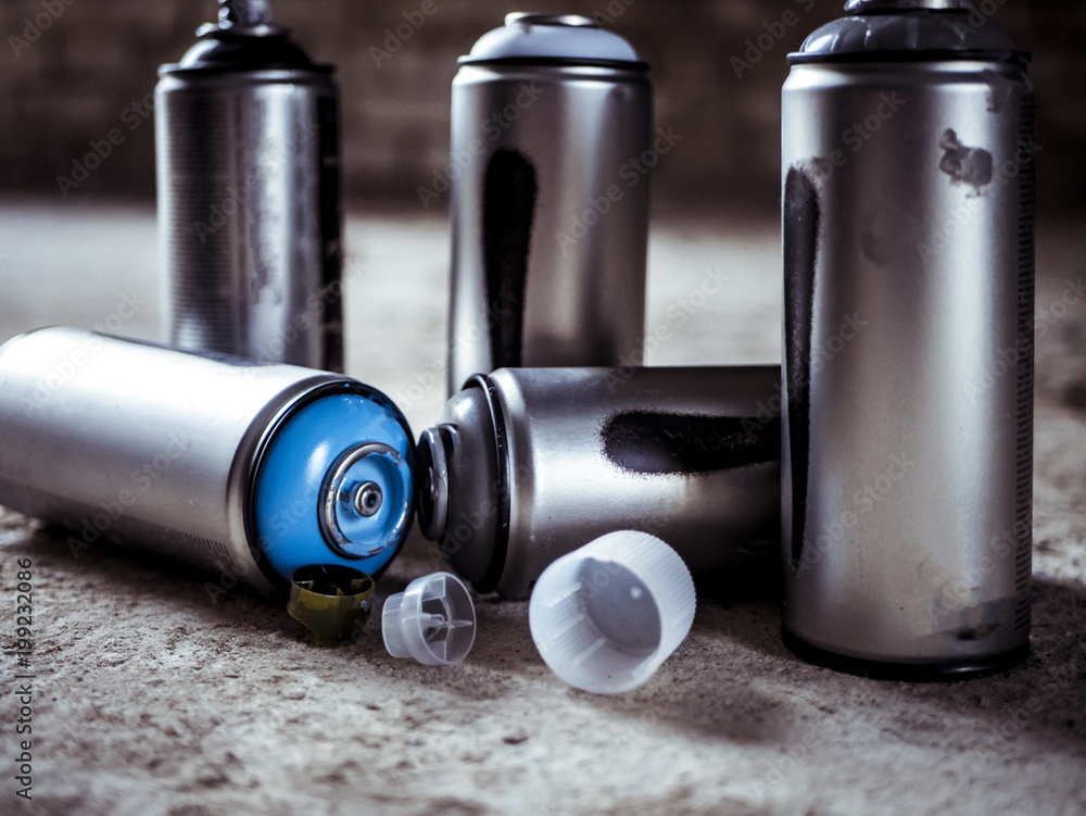 Photo & Art Print used graffiti spray paint cans on the ground