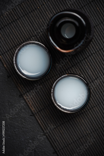 Sake in ceramic bowls, top view