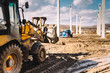 close up details of massive heavy duty machinery, industrial backhoe loader with excavator on construction site