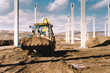 Industrial backhoe excavator and loader carrying earth and working on construction site