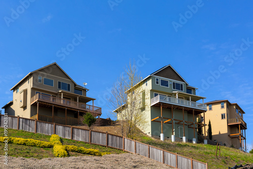 Fotografie, Tablou Homes on Stilts along Hillside Lots