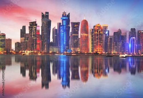 Vászonkép  Doha skyline of West Bay Center during sunrise, Qatar