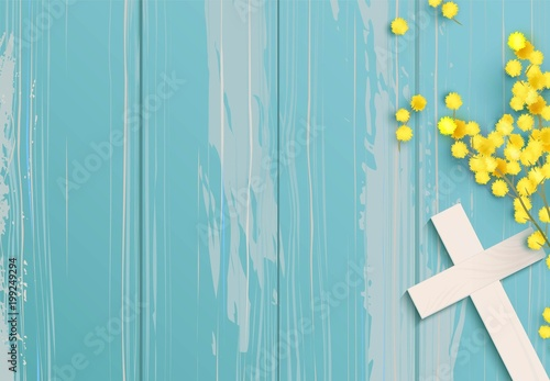 Fotomural White  cross and mimosa banch on blue rustic wooden background