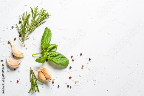 Keuken foto achterwand Aromatische Spices and herbs over white stone table top view.
