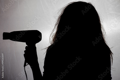 Obraz na plátně  the silhouette of a woman with tangled and damaged hair, a concept of beauty and