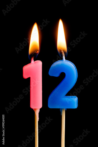 Burning Candles In The Form Of 12 Twelve Figures Numbers Dates For Cake Isolated On Black Background Concept Celebrating A Birthday Anniversary