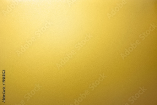 Photo  Gold texture. The smooth surface texture of the gold metal sheet